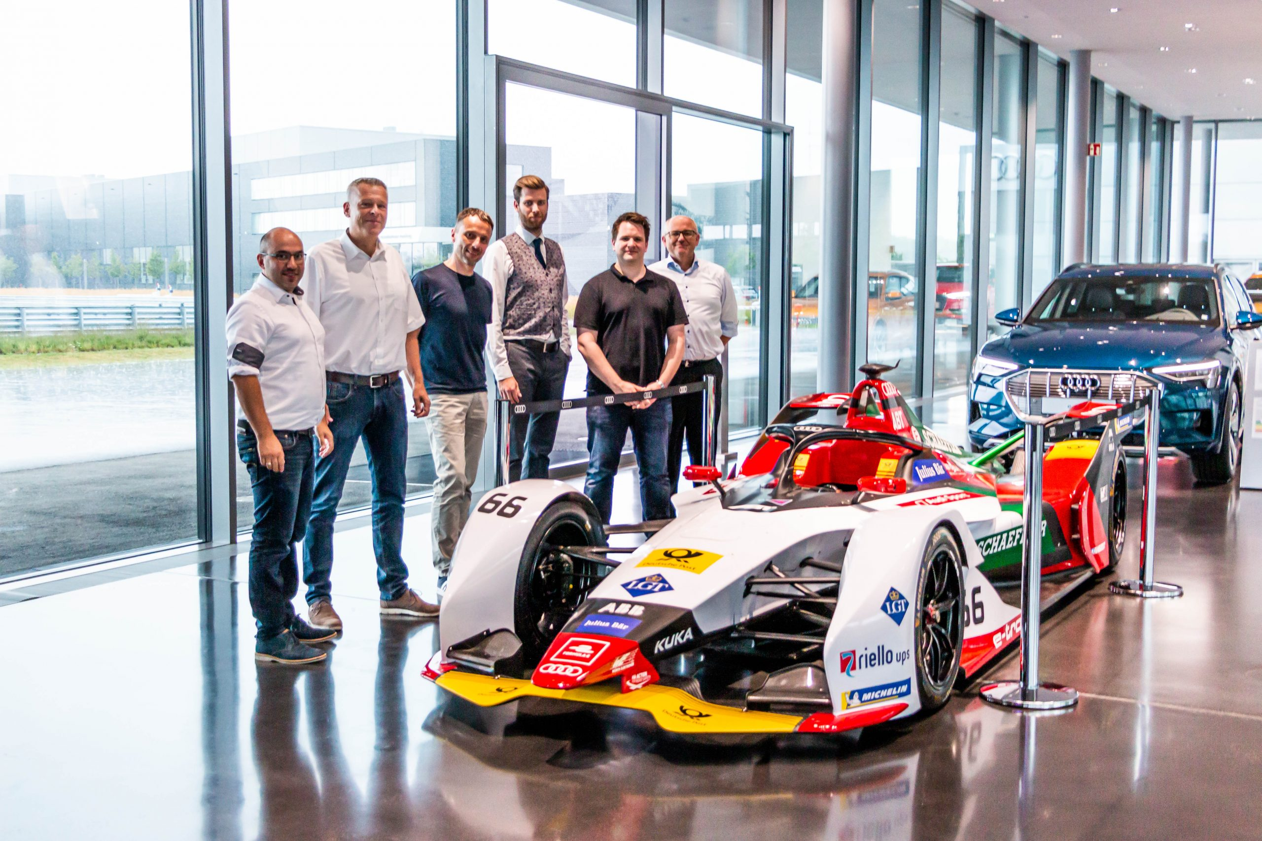 EDAG employees in front of a racing car